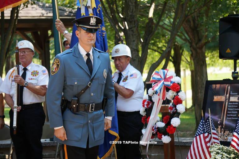 a Patrolman Thomas French places a wreath ©2019 TAPinto Montville.JPG