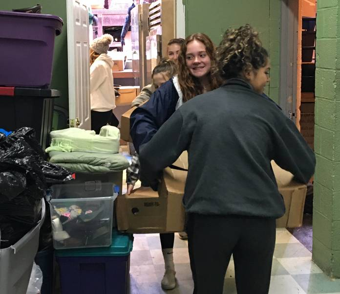 a Pictures of children filling the freezer at Father English Center csy Casha.JPG