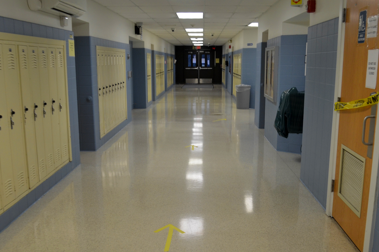 Arrows on the hallway floor to direct foot traffic at Scotch Plains-Fanwood High School.