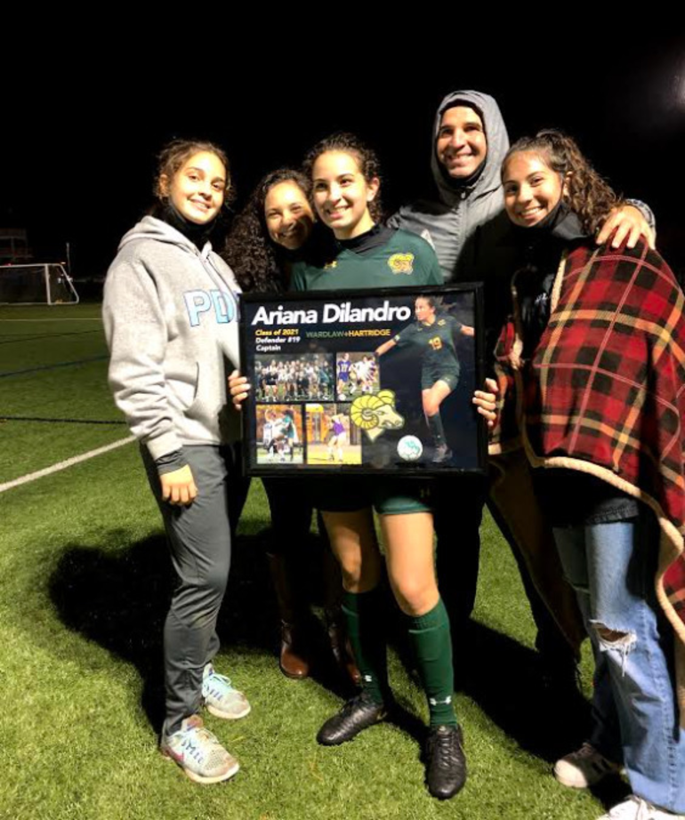 Ariana Di Landro is joined by her family at the team's Senior Night festivities last fall.