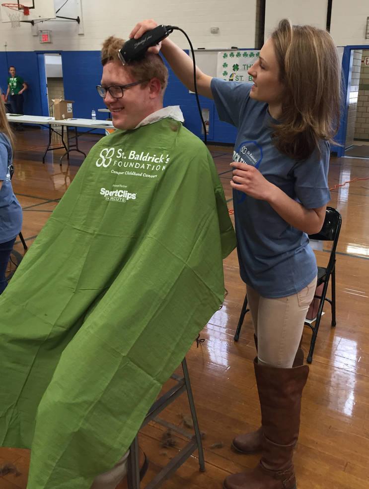Asst Principal Hamer gets head shaved.JPG