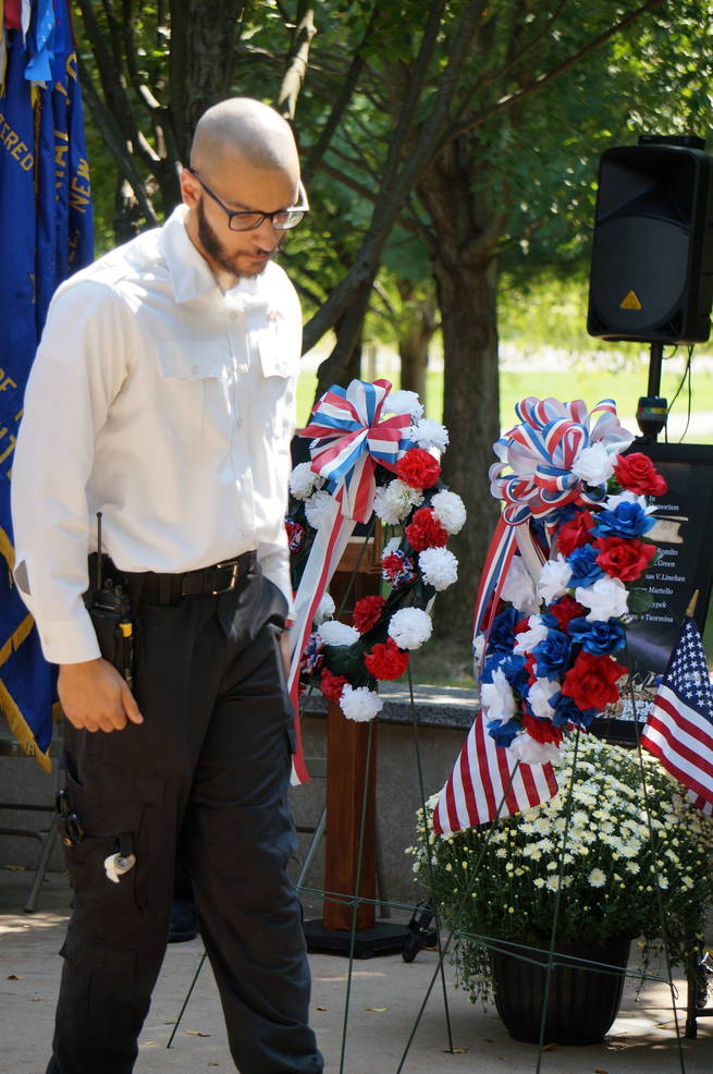 a Sal Khan of the Montville Twp First Aid Squad places a wreath  ©2019 TAPinto Montville.JPG