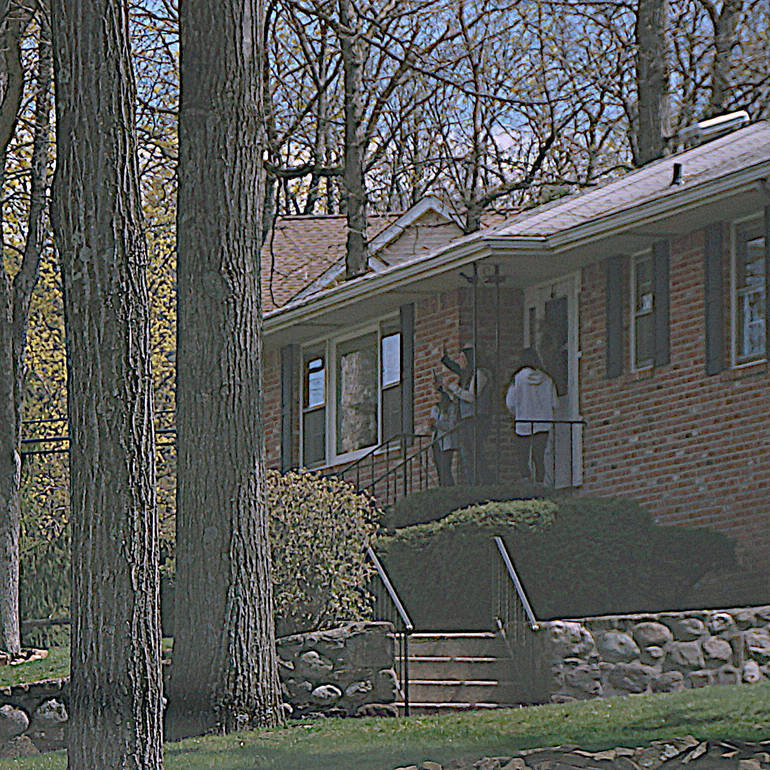 a The Bilenski family watches the motorcade from their porch sharpen.JPG