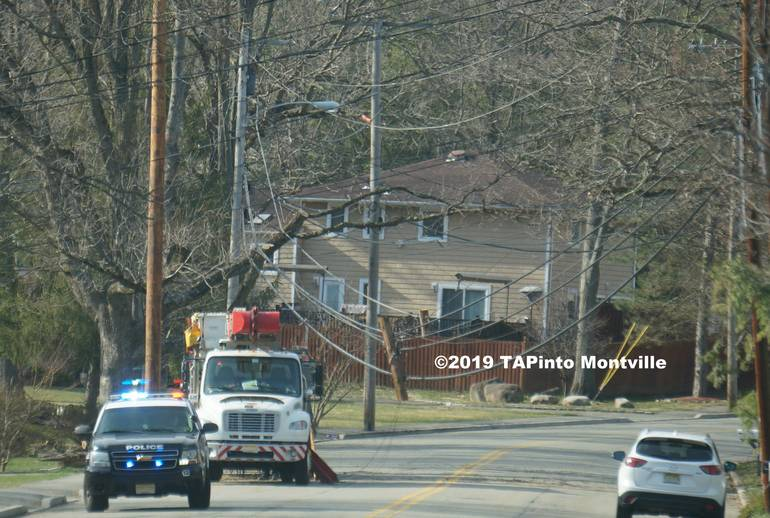At 500 p.m. the damaged pole and hanging wires could still be seen ©2019 TAPinto Montville PAINT.jpg