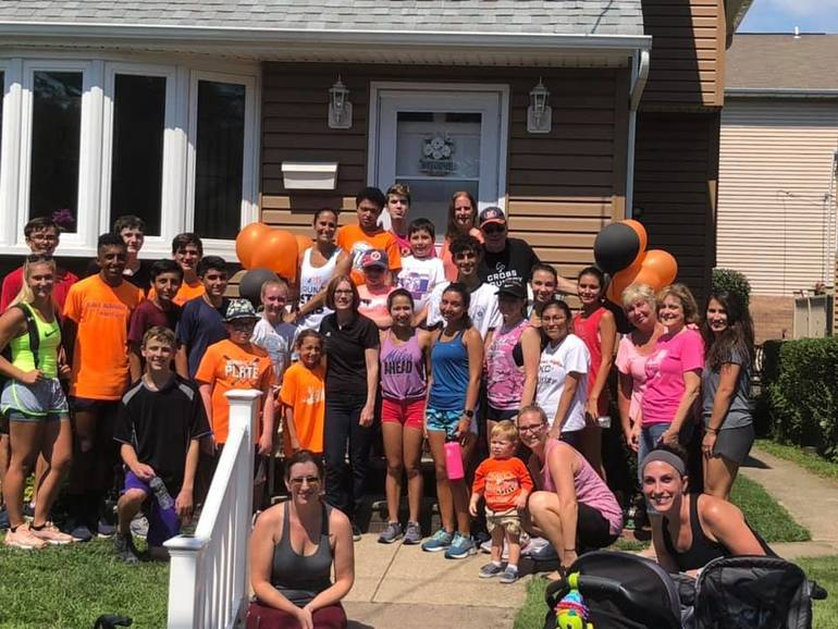 At ER home with family and HH XC team.jpg