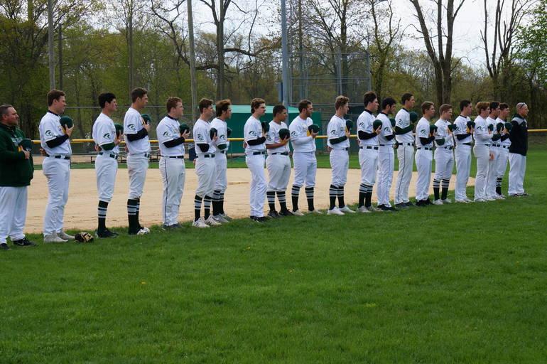 a The Montville Township High School varsity baseball team stands for the National Anthem ©2019 TAPinto Montville.JPG
