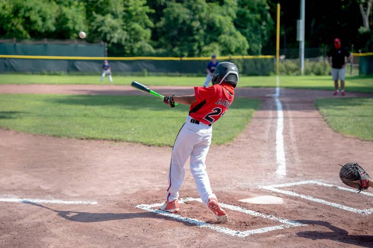Austin Lanera hits to center field.JPG