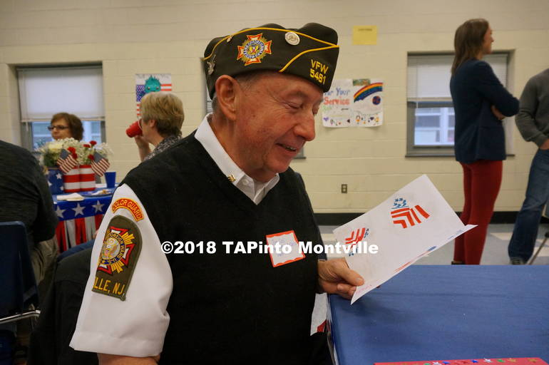 A Veteran Joe Coll reads one of the students' thank you cards.JPG