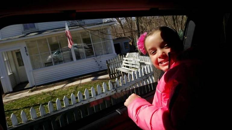 Ava Trinchitella  spots a house flying an American flag.jpg
