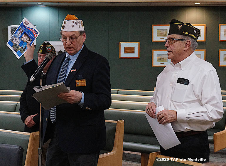 a VFW Post 5481 Commander Ken Hanzl holds up the ad book for the post's anniversary dinner ©2020 TAPinto Montville.jpg