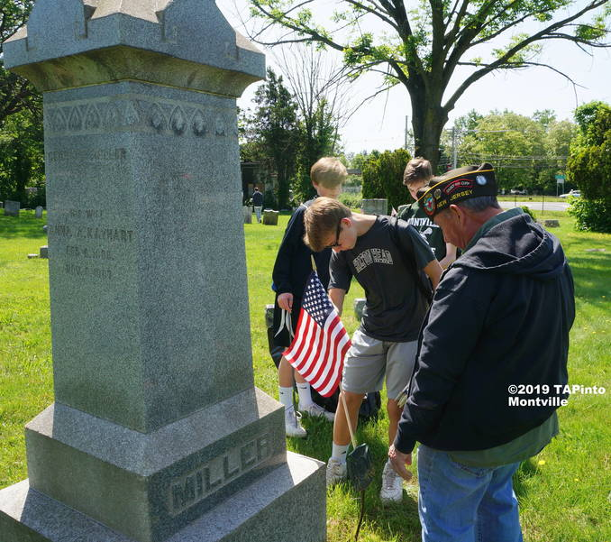 a VFW member Joe Coll helps Lazar students place flags ©2019 TAPinto Montville   2.JPG