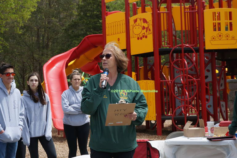 a With 'Montville Farms in the background Lori Dent talks about the new playground ©2019 TAPinto Montville.JPG