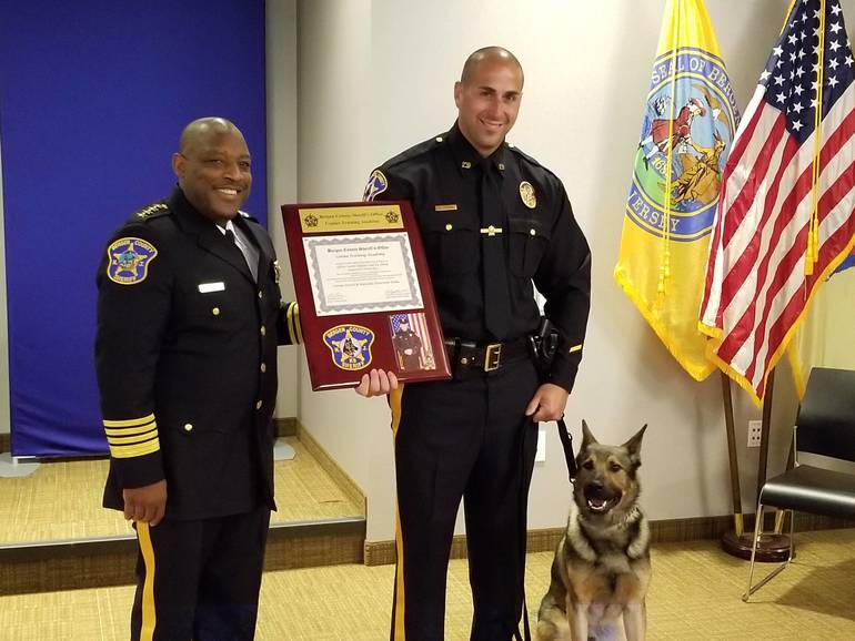 BCSO Ofc. Justin Epifano and his canine Johny.jpg