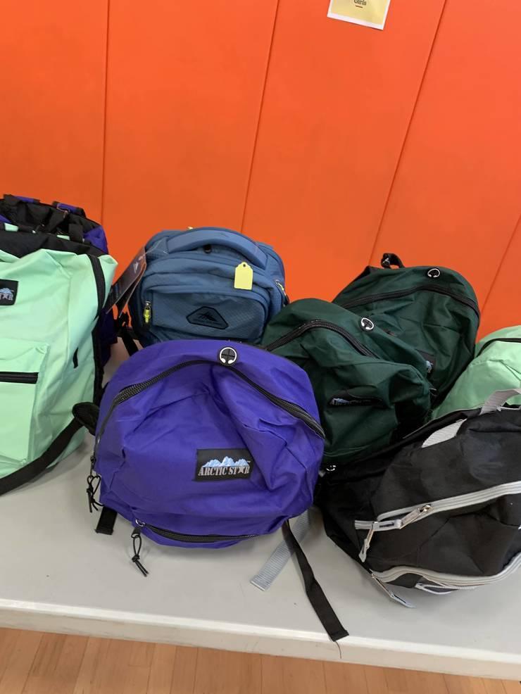 Backpacks for grades 1 through 4.