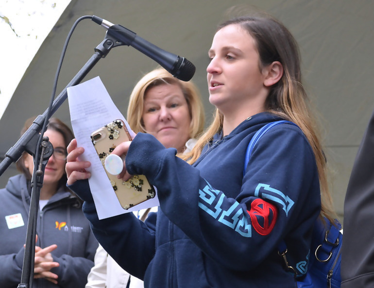 Mallory Banks addresses the crowd at the 4th annual Rockin' for Autism as s_Fanwood_Mayor_Colleen_Mahr_listens.png