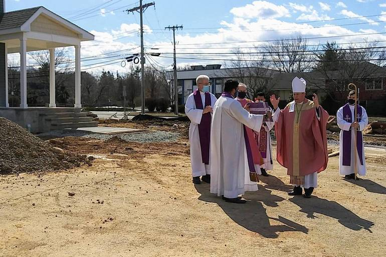 Bishop Blesses New Rectory in Roxbury