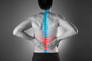 Carousel image 84facac96ab645b0e9d5 bigstock pain in the spine a man with  226272886