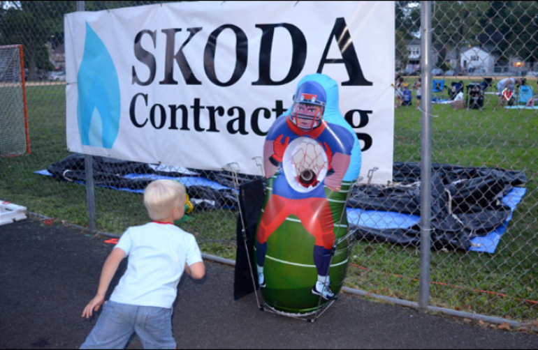 Boy plays football toss at Fanwood's National Night Out.png