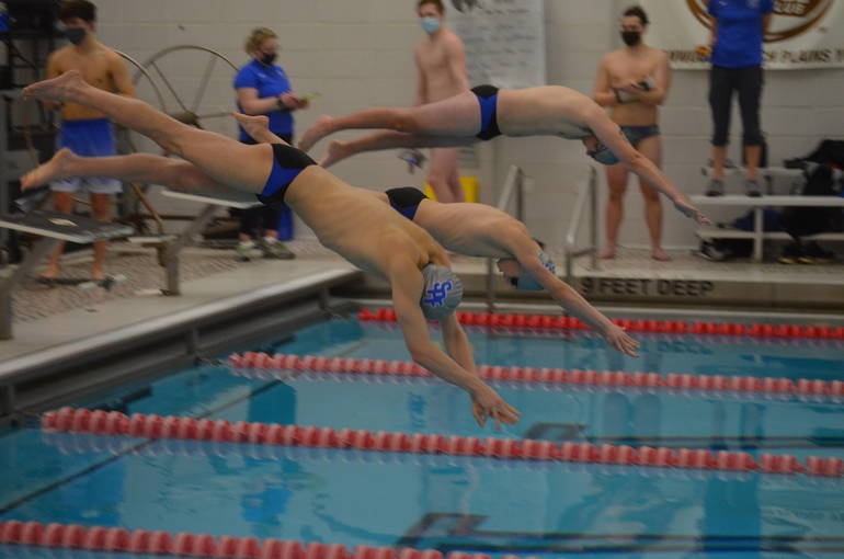 Scotch Plains-Fanwood swimming's season opener: start of the boys 200 Free Relay.