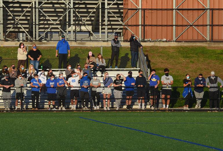 Scotch Plains-Fanwood's boys team cheers on the girls.