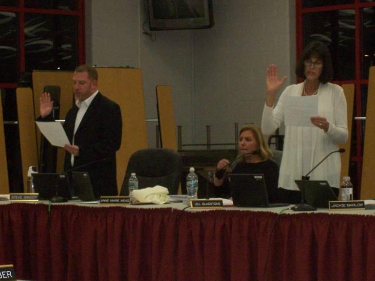 Steven Singer and Jill Gladstone are sworn in.
