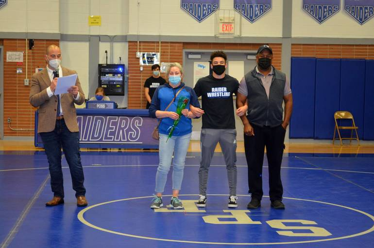 Scotch Plains-Fanwood senior wrestlers were accompanied by their parents as coach Marc Fabiano introduced them on Wednesday, April 15, 2021.