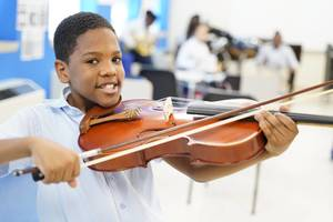 Carousel image 0d326a6d2a5ccc704fa3 boy with violin