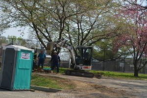 Carousel_image_c10a3670b37ec7ffcd28_bobcat_excavator_rear_of_belmont_hills_library