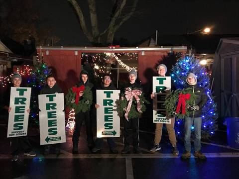 Top story 179c66616b091d6aa80c boys with tree signs