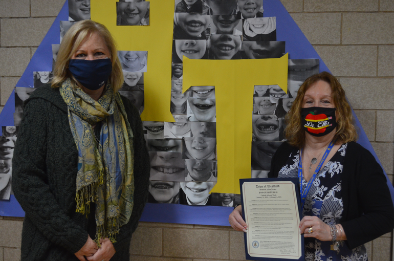 Westfield Mayor Shelley Brindle presented a proclamation from the town to Holy Trinity principal Dr. Adele Ellis on Thursday.