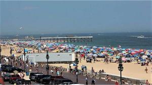 Carousel image d0a17cd46fa046f9be48 bustling belmar beach   mark walsifer