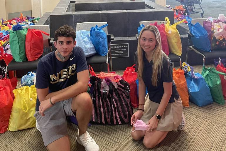 Kids Care Club Delivers 450 Mother's Day Tote Bags to Local Area Women in Need