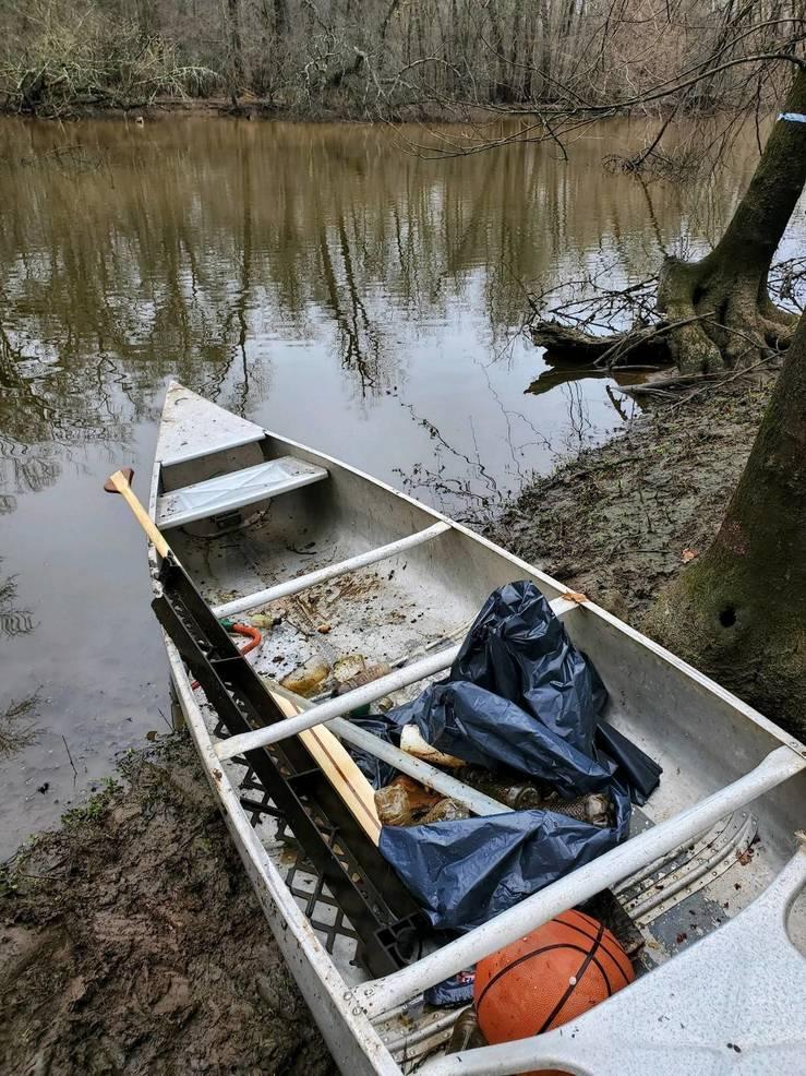 Canoe with trash.jpg