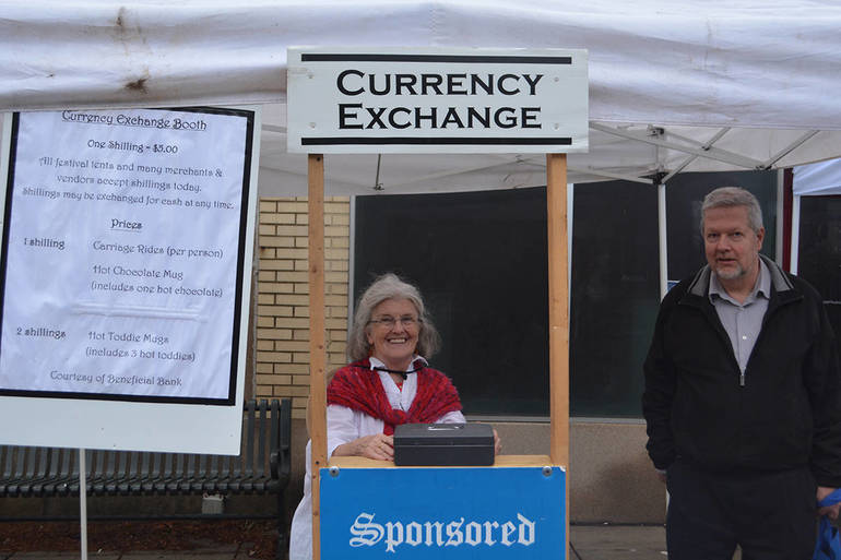 Carlyn Nelson mans the Currancy Exchange Booth 1st time attendee from Narbert after moving in during Sept..JPG