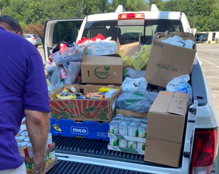 Pick-up truck loaded with donated food at Fanwood station.