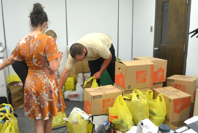 Canned food weighed by Foodstock volunteers at the Scotch Plains Municipal Building.
