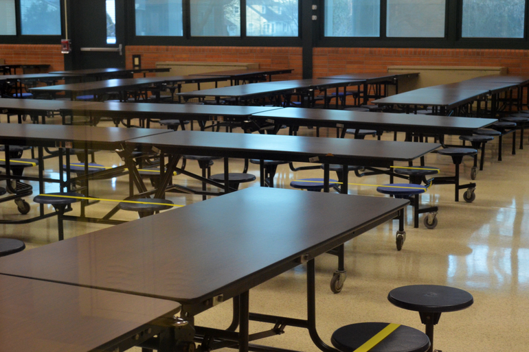 Scotch Plains-Fanwood High School cafeteria with social distancing markers.