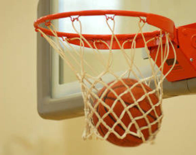carousel_image_d75dc445ed56a26a79db_Basketball_through_hoop.jpg