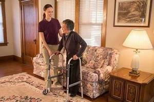 Carousel image 40701dc771f89d03fe55 caregiver senior using a walker 7