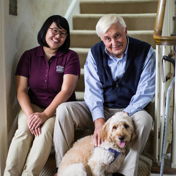 Top story d18c857286b675ef641e caregiver and senior male on stairs with dog.jpg high resolution