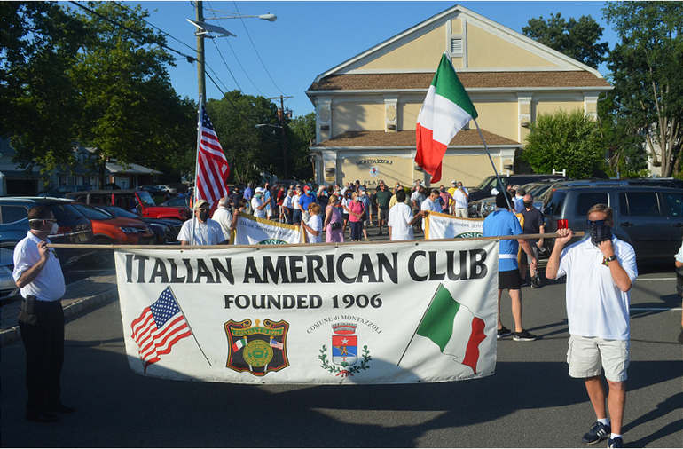 March in support of the Scotch Plains Columbus monument on Tuesday, July 21, 2020.