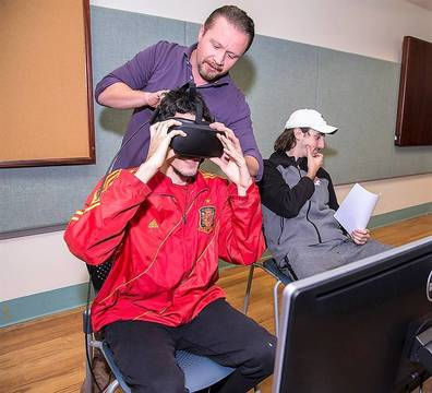 Top story 83f0c63983fcaffc55ba ccm.web professor brian olson with student in virtual reality lab