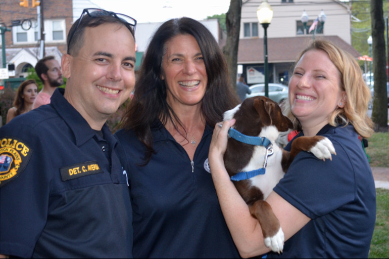 Chris Aversa, Margaret Heisey and Elizabeth Stamler with a furry friend at Scotch Plains National Night Out.png