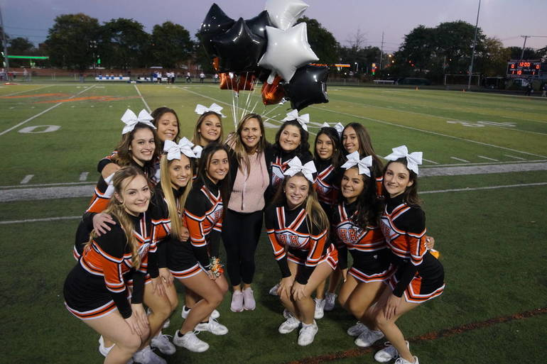 Cheer group shot with coach.jpg