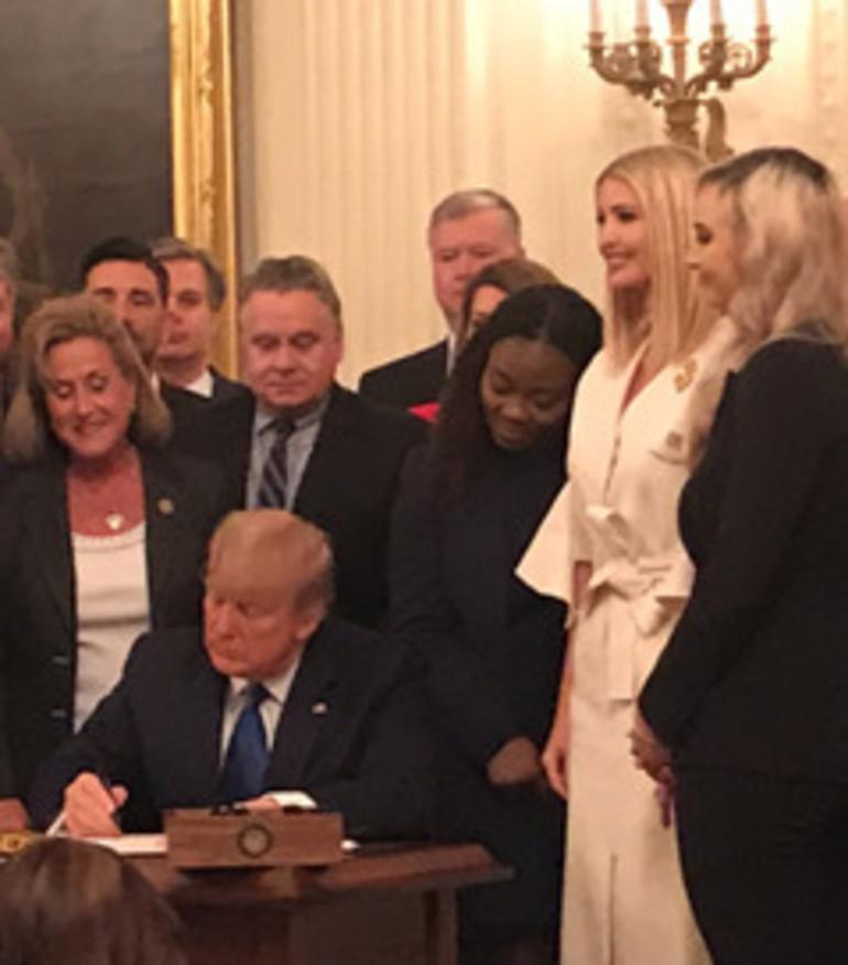 Chris Smith and Trump at Human trafficking.png