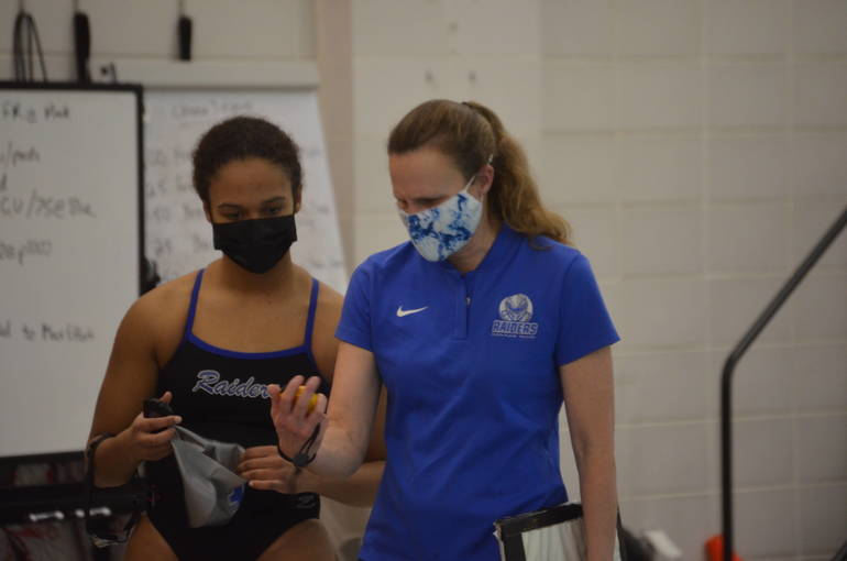 Scotch Plains-Fanwood swimming's Chloe Howell (left) with Coach Jess Hulnik (right).