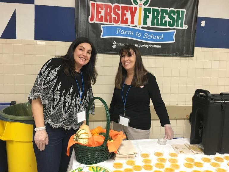 CMS Vice Pres and parent dietician serving soup.JPG