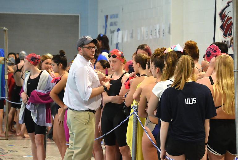 Coach Frank pumps up his team.png