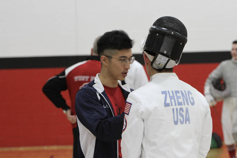 Coach Wang strategizes with junior epee Chris Zheng before a win at West Essex.jpg
