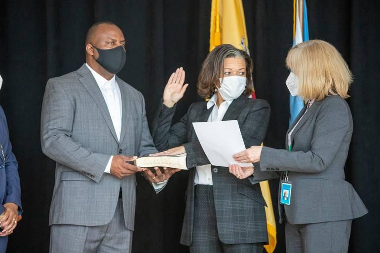 Commissioner Mccullum sworn in by County Clerk Nancy Pinkin.jpg